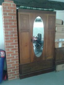 Large Wardrobe in solid wood with large bottom draw.
