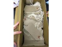 Brown paper labels with white string