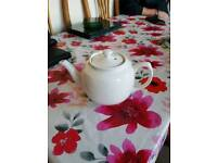 Small white teapot