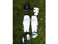 Junior's cricket helmet, pads, thigh pad, gloves & spikes