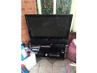 LG 42 inch TV with TV stand/sound bar