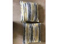 Yellow and grey cushions