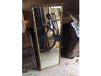 Gold framed large, rectangular mirror