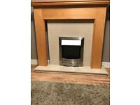 Electric fire place with wooden surround.