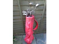 Set of vintage Wilson golf clubs in bag including a Mitsubishi putter