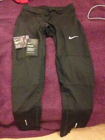 A Brand New Nike Men's running, size M