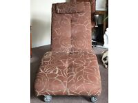 Upholstered Chaise Lounge and Rotating Tub-Chair.