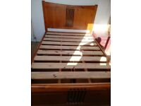 Free solid wood double bed.