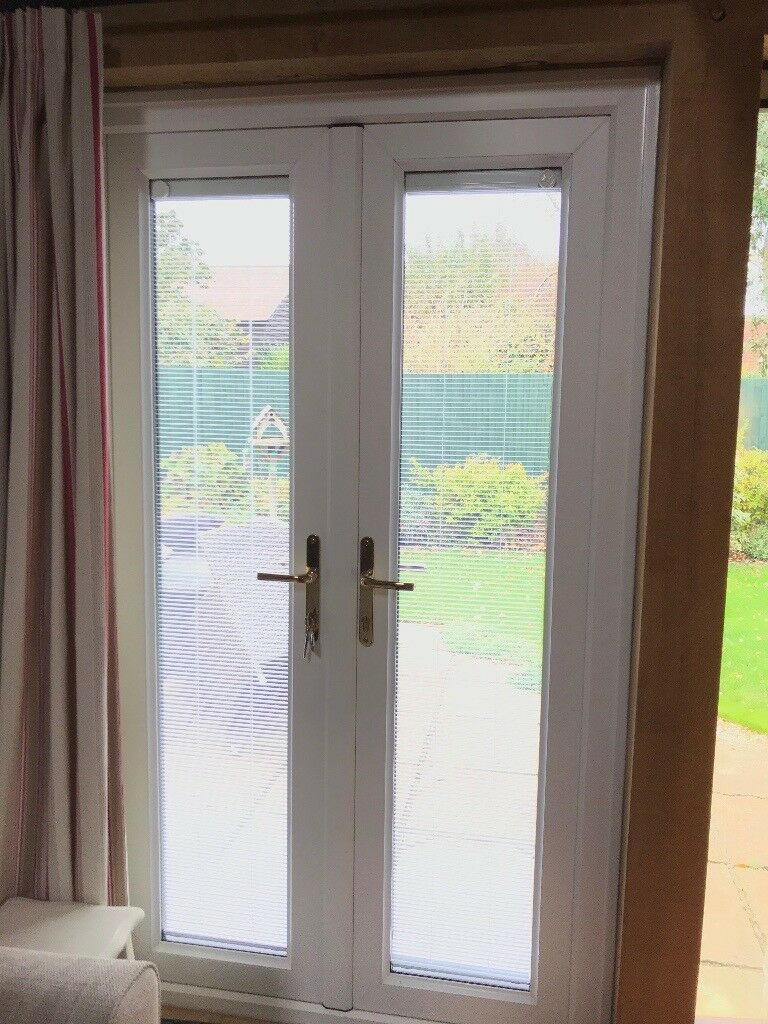 Double glazed Patio Doors in white/rosewood. 3 years old; excellent condition