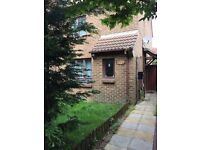 Double room in 3 bed house with off road parking, close to asda, station, charminster, town centre.