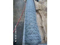 Chicken fence wire ; new roll 50 yards