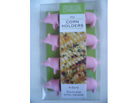 NEW and in original sealed packaging 4 sets Charcoal Companion Pig Corn Holders. Can post. £4 ovno
