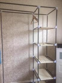 Double wardrobe shelving unit and coat hangers