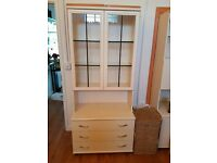 Large white display cabinet with integrated light