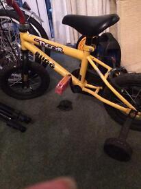 "Boys 14"" bike with stabilisers"
