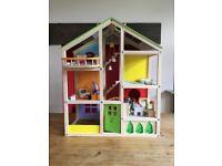 Hape all seasons dolls house & furniture. Plus Caucasian family.