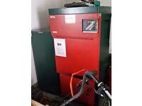 Wood pellet boiler and storage bin