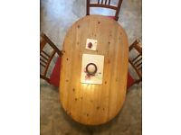 Oval shaped kitchen table and 4 chairs