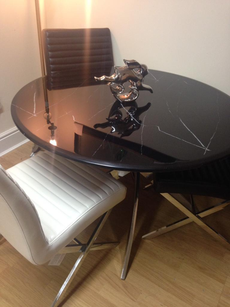 Black marble look glass dining table and chairs