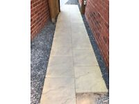 450 x 450 mm stone/buff coloured paving slabs