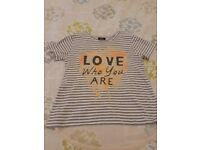 Grey and white striped t-shirt. 10-11yrs