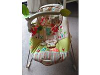 Fisher price baby bouncer neutral colours with calming vibrations button and forest play feature