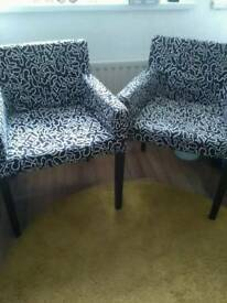 Pair of ikea chairs with two spare covers....