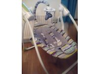 Baby swing / baby seat with music, toys and remote