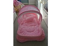 Pink baby portable bed