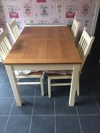 Dining table and 4 chairs, extends to seat 6 hardly used and in excellent condition