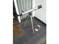Vivitar childs telescope with magnification on an adjustable tripot.