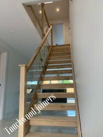 Glass panel hardwood staircase