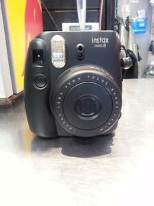 Fuji Film Mini 8 Instant Camera.  We Sell Used Camera. Get a Deal at Busters Pawn (113380)