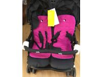 Used once still has tags unisex double pushchair