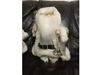 2 x wind up musical father christmas