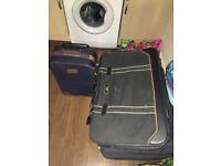 4x suitcases