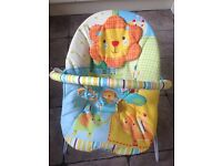 Bright Starts Jungle Baby Bouncer, excellent condition,vibrates and plays music, bar with toys incl