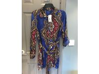 Blue quiz blouse. Cost 25. Still with tags. Size 16