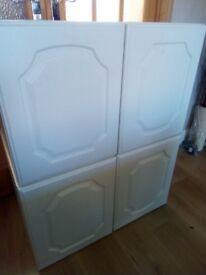 Two large white cupboards