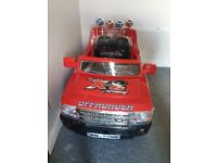 Red motorcross kids electric Jeep