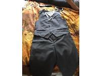 Boys grey trousers and waist coats