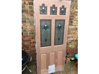 New front door 3ft by 7ft in packaging. Hardwood with glass patterned panes