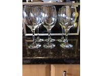 Six matching wine glasses