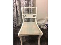 White chair with blue check seat.