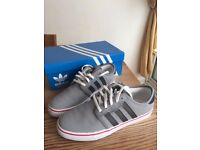 Adidas Seeley (size 8.5)- Carbon grey with black stripes