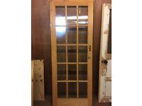 Glazed bevelled wooden door