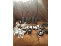 2way motorola radios x5 + 5 extra batteries x3 single chargers. 4 ear peices & 1x microphone