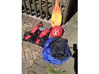 Kayak paddle, buoyancy aid, spraydeck and helmet.
