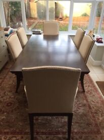 Beautiful wooden extending table and 8 chairs