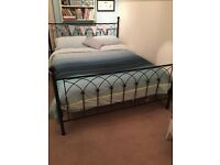 Metal framed king size bed and mattress, black - good condition only used as spare bed.